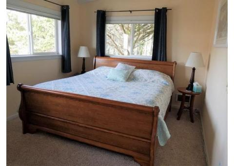 Beautiful Sleigh Bed with almost new Plush King Merry Box spring and Mattress